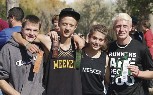 Four cross-country distance runners from Rio Blanco County qualified on Saturday to compete in this weekend's Colorado State Cross Country Meet on Saturday in Colorado Springs. From left to right are Meeker Cowboy distance runners Marshall Pool, Austin Russell, Julia Eskelson and Rangely Panther Patrick Scoggins, who took third overall.