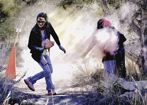 """Zombie Madison Kindler """"infects"""" one of the 35 runners who participated in ERBM Recreation and Park District's third annual Zombie Run, held as part of the Saturday events celebrating Halloween."""