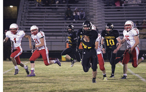 Meeker senior Devon Pontine broke out into the open and gained 43 yards on his one carry against the Hotchkiss Bulldogs in the final game of the regular season for the Cowboys on Friday. Pontine also caught three passes in front of a large hometown crowd in Starbuck Stadium and had 17 tackles on defense. The Cowboys will play in Bailey against the Platte Canyon Huskies in the first round of the 2015 1A Colorado state football playoffs.