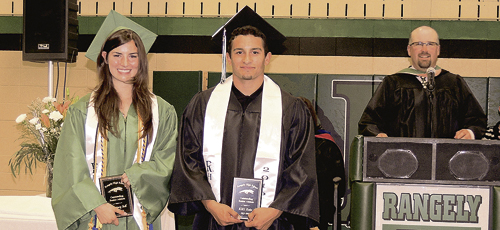 "Rangely High School Athletic Director Crandal Mergelman, back right, announced the top senior athletes on Saturday evening during the 2016 RHS Commencement Exercise. Winners of the awards were Courtney Bell, left, and Cristo ""Kiki"" Ruiz."