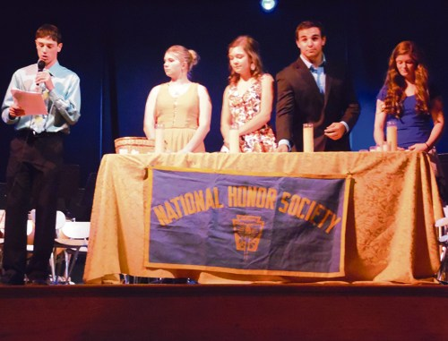 Meeker High School Scholastia Chapter National Honor Society President Nick Burri leads the induction of 17 new students as NHS members. He is assisted here in the opening ceremony, by Vice President Maggie Phelan and members Meghan Smith, Madeline Amack and T.J. Shelton.
