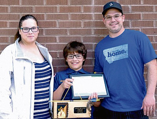 Rangely Cub Scout Ashton Cardin recently received his Arrow of Light award with Rangely Cub Scout Pack No. 191. The Arrow of Light is the highest award one can earn in Cub Scouts. Ashton is pictured here with his parents, Cherise and Don Cardin.