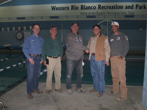 Chevron North America presented a check to Western Rio Blanco Recreation and Park District for $4,000 in support of after school and summer recreational programs for youth and other events that bring the community together. Pictured above is Chris Willard, Troy Waldner, Tim Webber, Nick Moschetti and Joey Medina. Courtesy Photo
