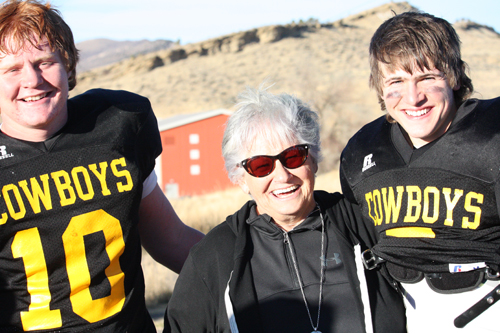 Becky Hughes photo Matriarch Annie Turner poses with Cowboy quarterback Logan Hughes and her grandson Sheridan Harvey after Meeker defeated the Bennett Tigers 34-24 in the state semifinals in Starbuck Stadium, earning them the opportunity to play the 2016 title game in front of their hometown crowd.