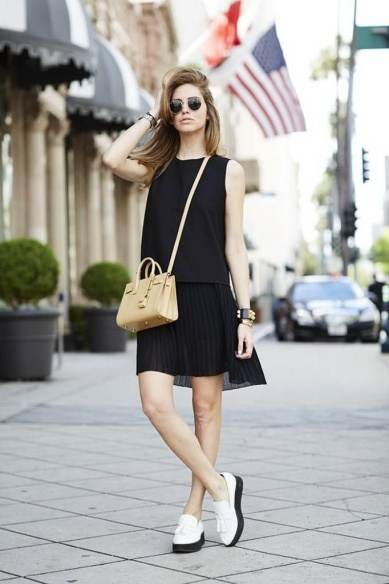 Black Dress Paired with White Loafers that feature black soles