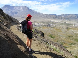 A hiker admires the Pumice Plain from the Boundary Trail on Johnston Ridge, by Craig Romano.