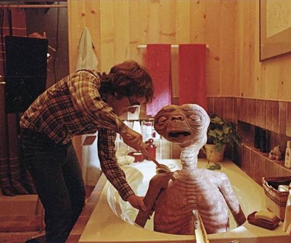 Steven Spielberg giving E.T a good bath time behind the scenes of