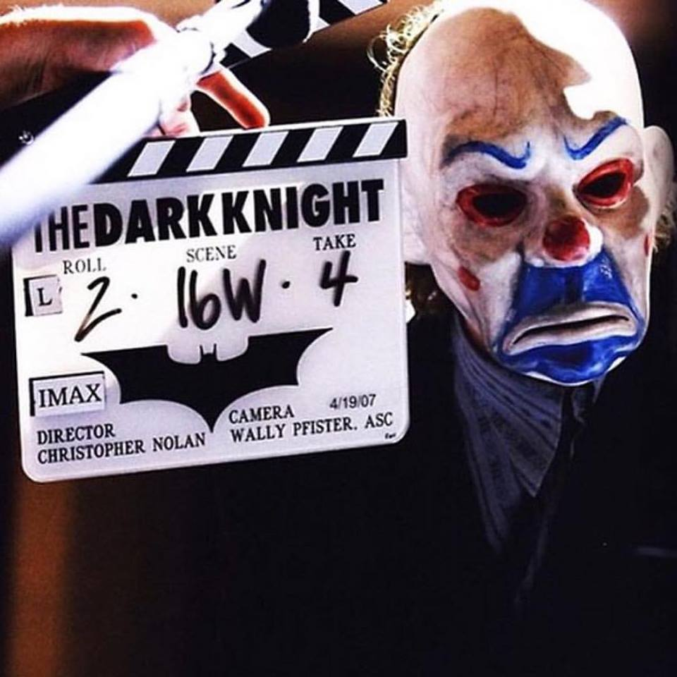 Heath Ledger shooting a bank robbery scene in 'The Dark Knight' (2008). The movie was written and directed by british filmmaker Christopher Nolan