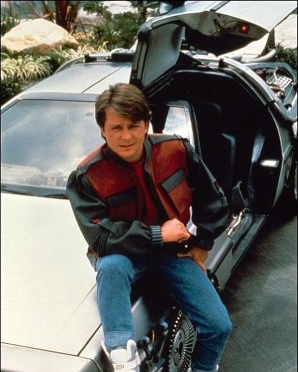 Michael J. Fox and the DeLorean Time Machine on the set of 'Back to the Future Part II' (1989)
