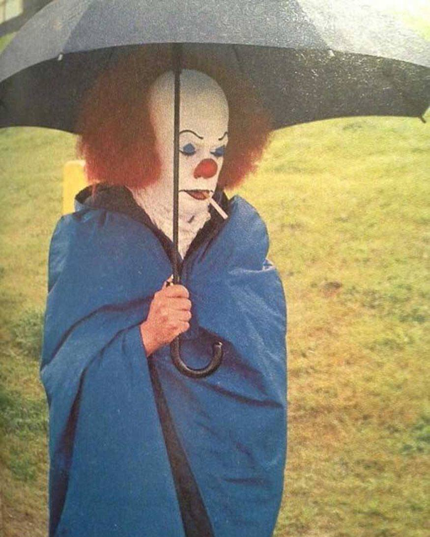 Tim Curry smoking a cigarette behind the scenes on the set of
