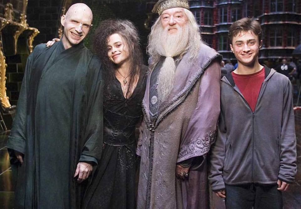 The key players pose during the shoot for the big finish of 'Harry Potter and the Order of the Phoenix' (2007). From left to right: Ralph Fiennes, Helena Bonham Carter, Michael Gambon and Daniel Radcliffe​.