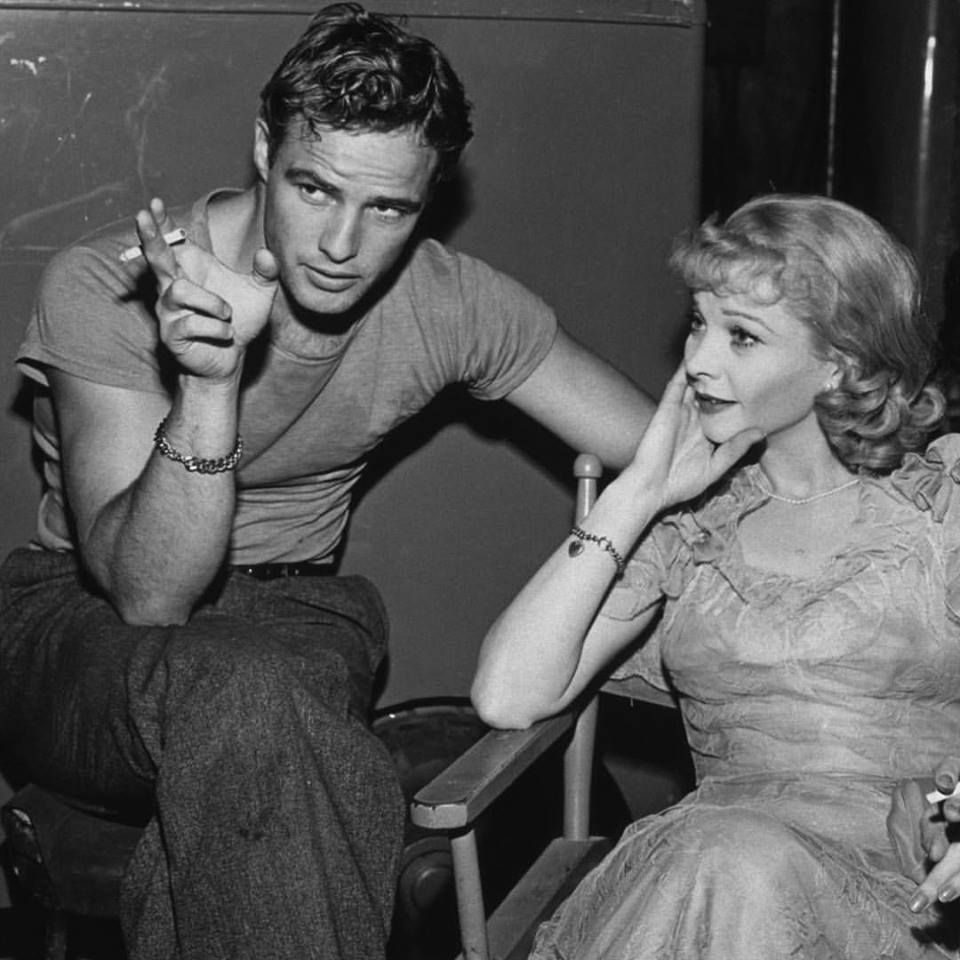 Marlon Brando and Vivien Leigh relax on the set of 'A Streetcar Named Desire', circa 1951