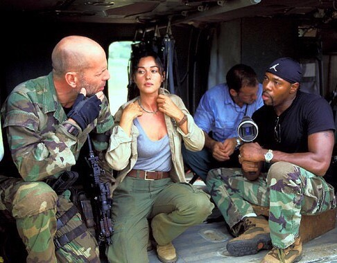 Bruce Willis, Monica Bellucci and director Antoine Fuqua behind the scenes of 'Tears of the Sun' (2003)