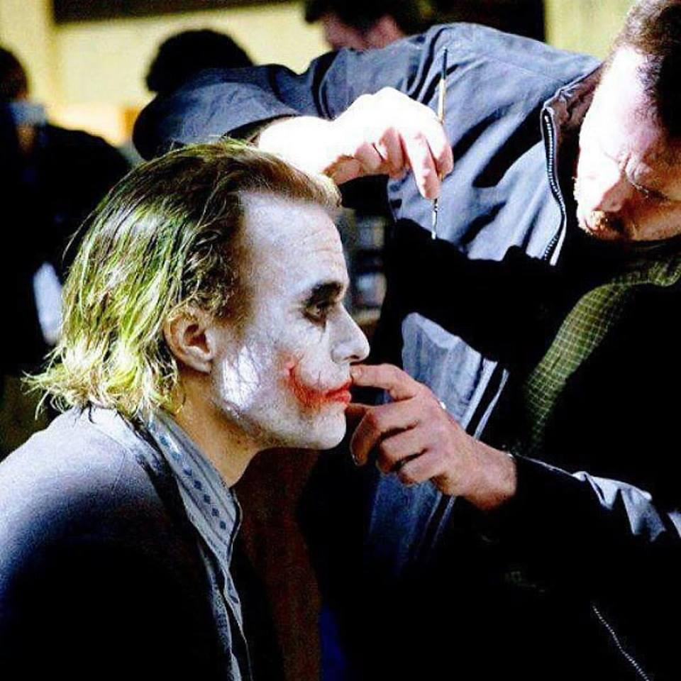 "Heath Ledger (The Joker) has his make-up fixed while shooting ""The Dark Knight"" (2008)"