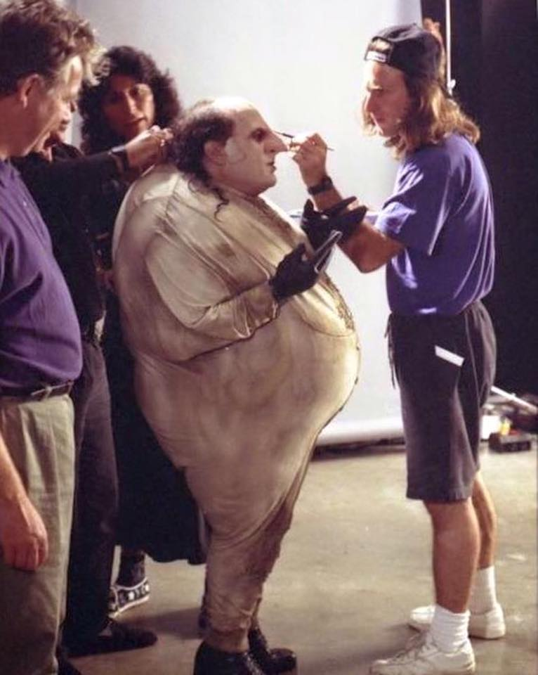 Behind the scenes: Danny DeVito with Penguin outfit getting ready for a scene in 'Batman Returns' (1992)