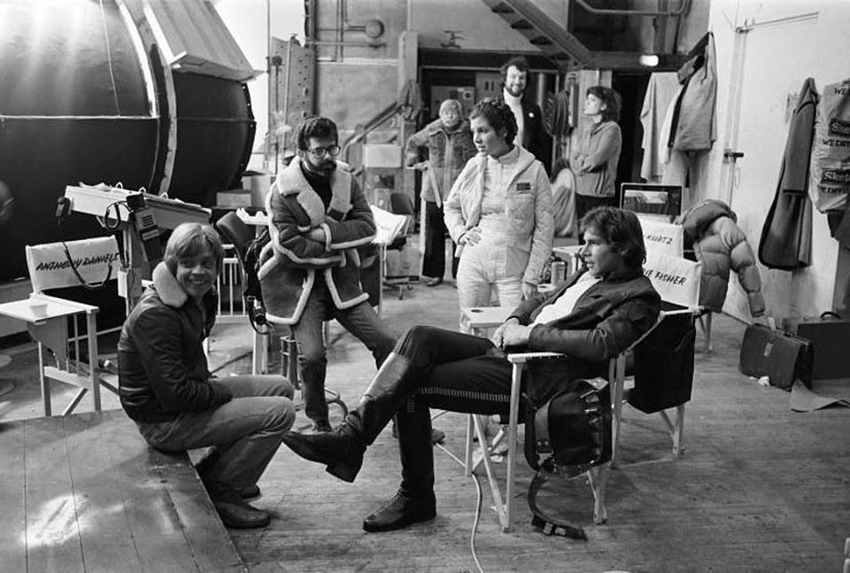 Mark Hamill, Carrie Fisher, Harrison Ford take a break with George Lucas in the set of 'Star Wars: Episode V - The Empire Strikes Back' (1980)