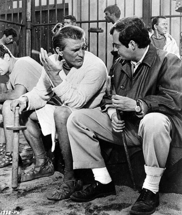 A rare photo of actor/producer Kirk Douglas and director Stanley Kubrick talking between shots of Spartacus in 1957