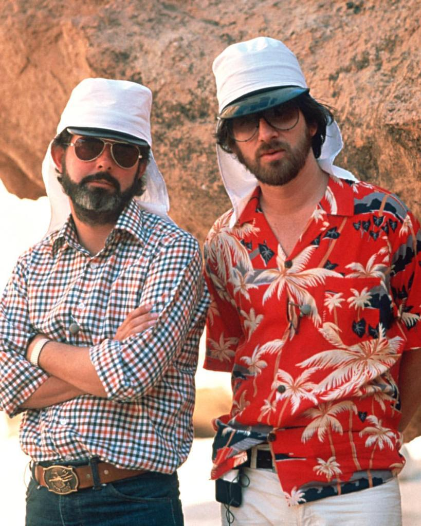 Behind the scenes photo of Steven Spielberg & George Lucas on the set of
