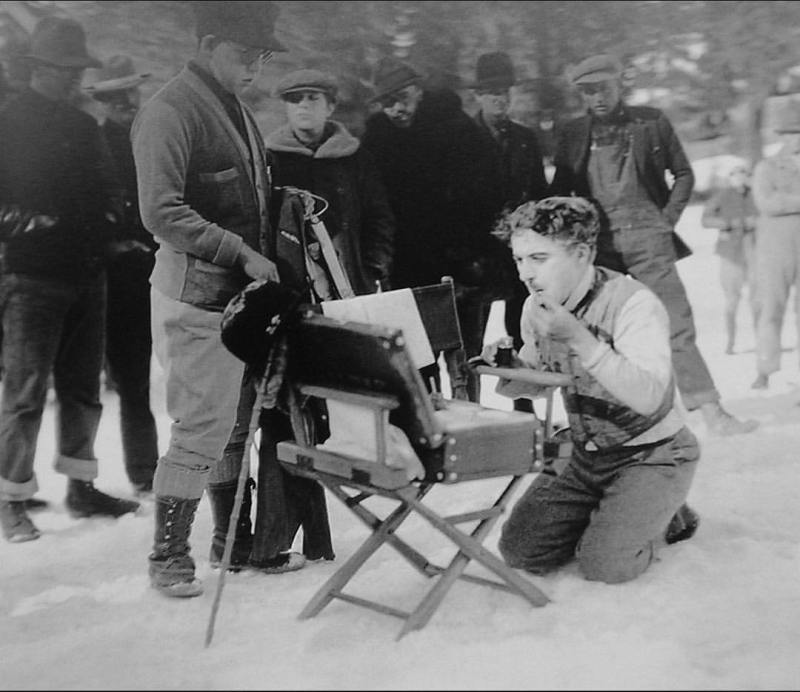 Charles Chaplin retouching his makeup on the set of 'The Gold Rush' (1925)