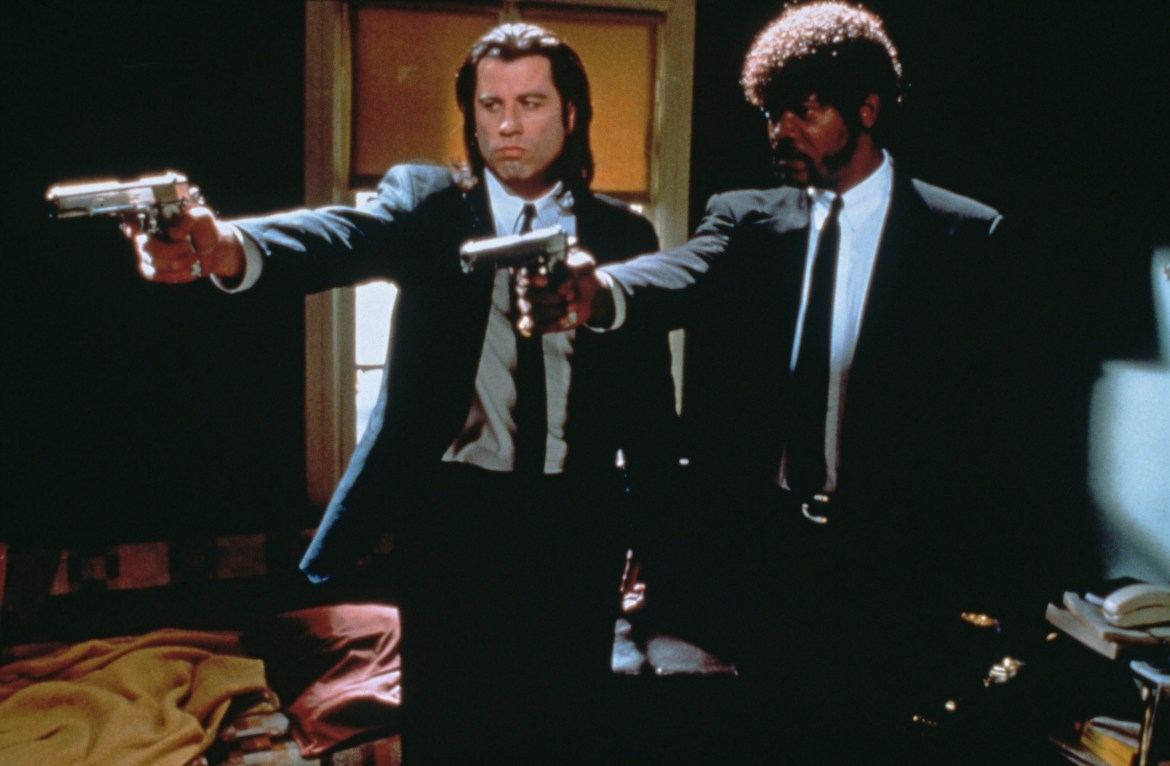 American actors John Travolta (left) as Vincent Vega and Samuel L Jackson as Jules Winnfield in a scene from 'Pulp Fiction', directed by Quentin Tarantino, 1994