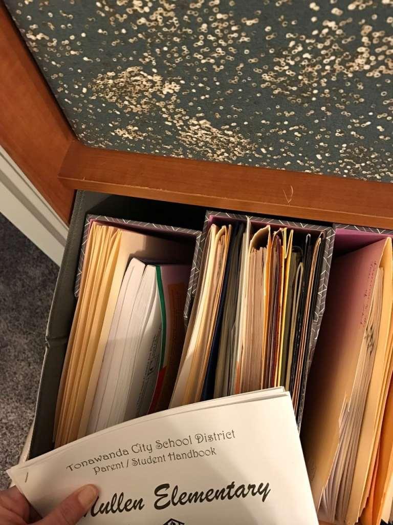 Kids' school year paperwork.