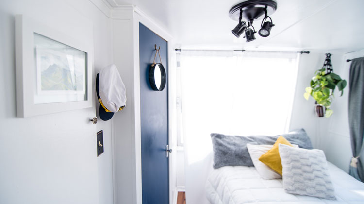 Blue Door and Window With White Curtain Inside Well-Lighted Room