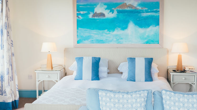 White and Blue Pillows beside Brown Table Lamp