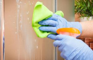 how to get hard water stains off glass shower doors