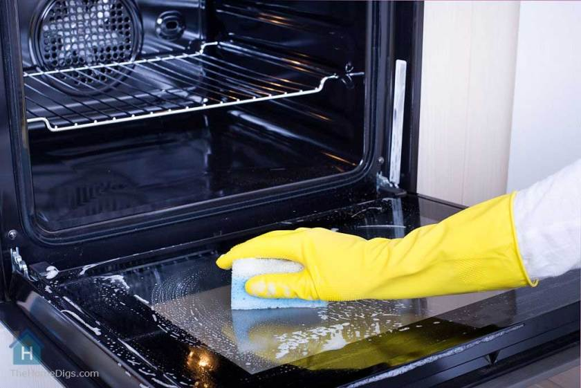 cleaning the oven with non toxic oven cleaner and foam scrubber