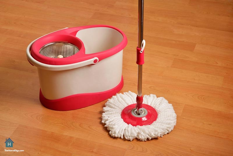 sweeping hardwood floors with cleaning-mop