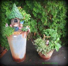A double decker fairy garden