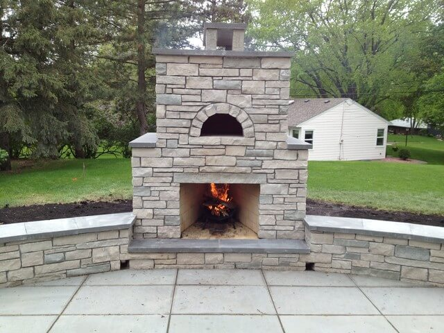 Outdoor fireplace with pizza oven