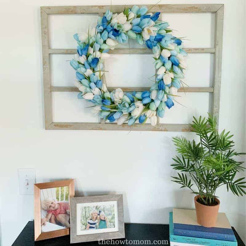 Hang a wreath on an empty window frame