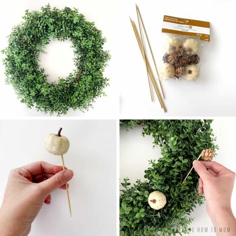 boxwood wreath with neutral mini pumpkins and pinecones