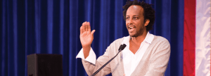 """DANIEL SMITH/THE HOYA Author Dinaw Mengestu speaks at New Student Orientation's Marino Workshop on Monday, for which one of his novels, """"All Our Names,"""" was required reading for all incoming freshmen for the second time in four years."""