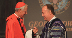 MICHELLE LUBERTO FOR THE HOYA Georgetown University awarded Archbishop of Washington, D.C. Donald Cardinal Wuerl with an honorary degree Monday evening in Gaston Hall. Board of directors Chair Paul Tagliabue (CAS '62) presented the degree.