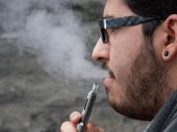 FILE PHOTO: DANIEL SMITH/THE HOYA Juan Luis Tirado (COL '16) smokes an e-cigarette. In their report, Cobb and Abrams called for FDA approval of e-cigarettes.