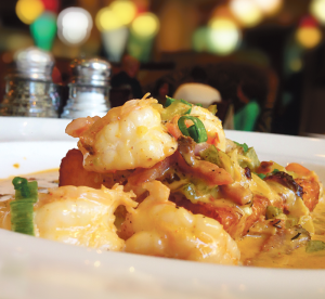 YIWEN HU/THE HOYA Acadiana offers fresh, exceptional versions of classic Louisianan dishes like this delicious plate of southern shrimp and grits.