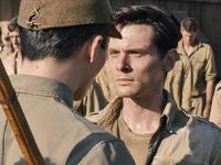 "COURTESY S.YIMG.COM Jack O'Connell plays Olympian and Air Force Lieutenant Louis Zamperini in Angelina's directorial debut ""Unbroken."""