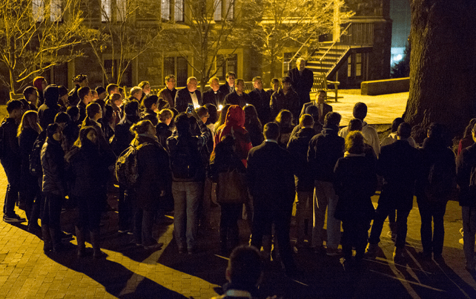 ALEXANDER BROWN/THE HOYA Around 100 students joined to mourn the deaths of three Muslim students in a shooting at UNC Chapel Hill.