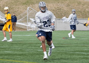 FILE PHOTO: CLAIRE SOISSON/THE HOYA Sophomore midfielder Devon Lewis exploded for a season-high three goals in No. 13 Georgetown's 12-9 loss to No. 9 Virginia. Lewis had only scored six goals in the team's first 12 games this season.