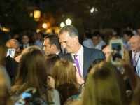 NATE MOULTON/THE HOYA The new Spanish monarch, King Felipe VI (GRD '95), accompanied by Queen Letizia, was thronged by students and security during his visit to campus Wednesday night.