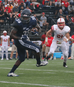 FILE PHOTO: ISABEL BINAMIRA/THE HOYA Senior running back Jo'el Kimpela rushed for 46 yards on seven carries in Georgetown's loss to Harvard last Friday. Kimpela has rushed for 224 yards and one touchdown this season.