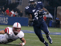 FILE PHOTO: ISABEL BINAMIRA/THE HOYA Sophomore running back Isaac Ellsworth recorded 250 all-purpose in the Hoyas' 38-31 loss to the Fordham Rams.