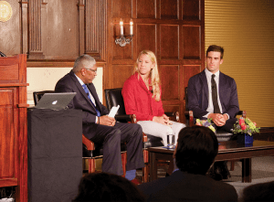 CAITLYN BRANDON FOR THE HOYA Athletic Director Lee Reed, left, moderated a discussion between Olympians Michelle Konkoly (COL '15) and Charlie Buckingham (COL '11).