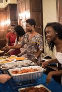 Kristen Okoro, Danielle Maduka, Eliza Phillips, and Ojuolape Junaid serve food to Ubuntu diners STEPHANIE YUAN/THE HOYA
