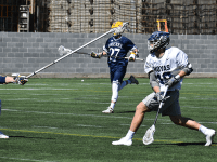 MARGARET FOUBERG/ THE HOYA | Junior attack Jake Carraway fires a shot against Drexel on March 16. Carraway tallied 4 goals in the win.