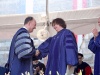 GEORGETOWN LAW CENTER FACEBOOK PAGE | New York Solicitor General Barbara Underwood (LAW '69), who addressed graduates at commencement, shakes hands with Georgetown University President John J. DeGioia.