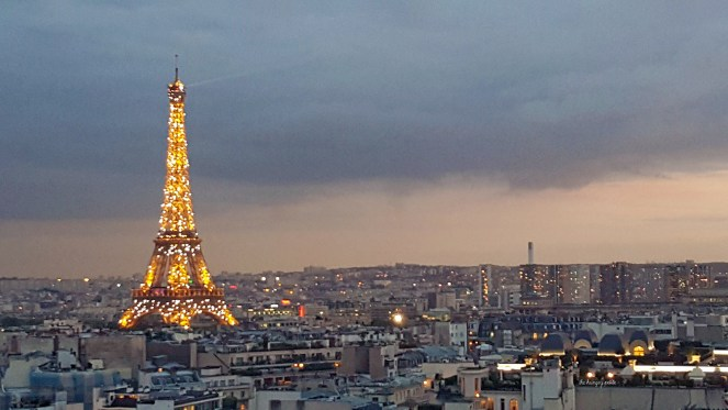 After sunset while the Eiffel Tower is sparkling with lights