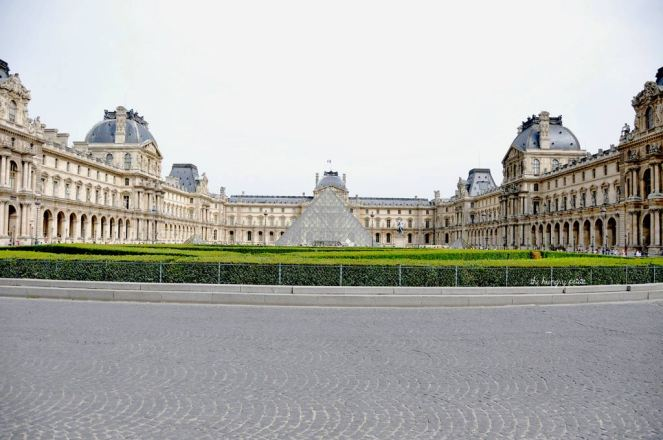 Rare sight of no tourists in front of the Louvre pyramid